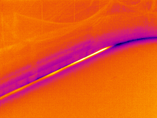 This image is from an early test of thermal imaging for detecting leaks in hockey arena cooling lines. A specific line was isolated and how water was introduced from each end to isolate the leaking portion.