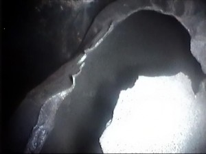 A videoscope was used to inspect the shell-side of an exchanger to observe an area of a damage tube.The image shows the tube ruptured outwards.