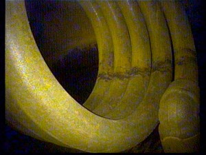 The image shows the tower's bottom heating coils after steam cleaning. The client noted that flash rusting and some oxidization had developed after cleaning without inhibitors.