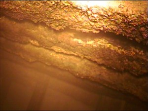 A high temperature and explosion-proof video inspection camera was used to capture the ceiling section of the pit. The panels are showing separation and deterioration.