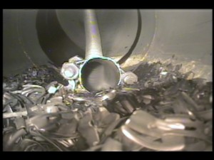 This image shows removal of pieces of the reactor tray media and build-up with a vacuum. Maverick uses robotic crawlers to perform retrievals and guide cleaning companies.
