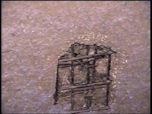 A video inspection camera was lowered down from the top of the furnace stack to assess the refractory condition. This image shows loss of refractory material exposing wire mesh.