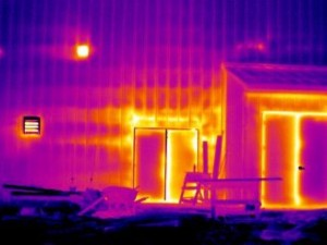 The doors and portions of the wall in this image show failures in the building envelope and missing insulation when viewed with a thermal imaging system