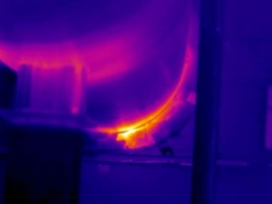 This image shows a leaking seal on a turbine enclusure around a cooling air line.