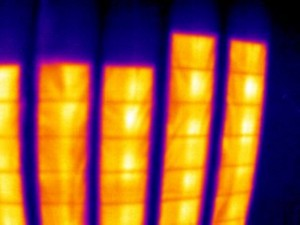 This image shows electric heating panels installed in the ceiling of an apartment condominium building